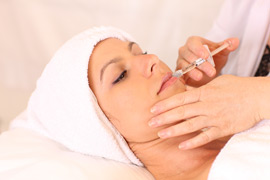 A woman receiving a Restylane® injection in her cheek