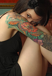 A woman with an full arm covered in tatoos